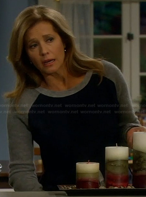 Vanessa's navy sweater with grey sleeves on Last Man Standing
