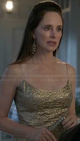 Victoria's gold spaghetti strap dress on Revenge