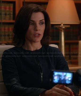 Alicia's navy jacket with leather sleeves on The Good Wife
