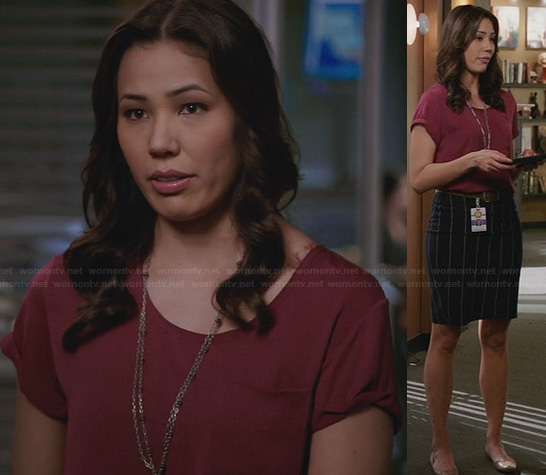 Angela's burgundy top and vertical striped skirt on Bones
