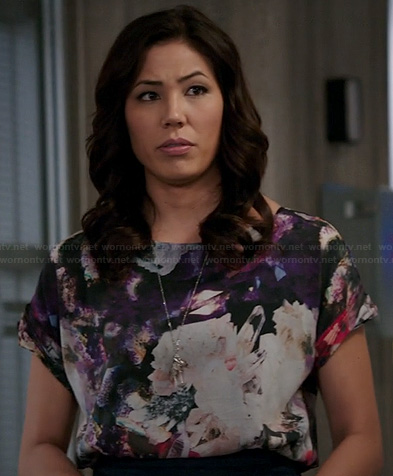 Angela's purple abstract printed top on Bones