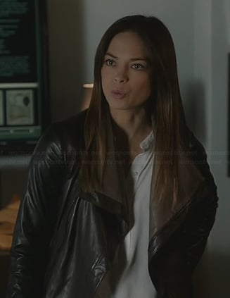 Cat's white half placket blouse and leather jacket on Beauty and the Beast