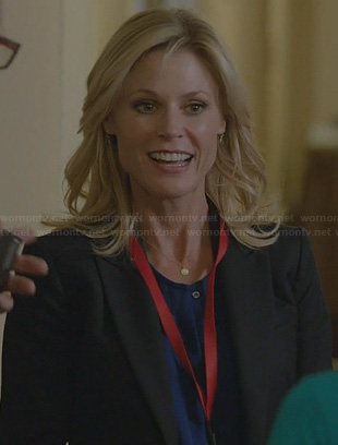 Claire's blue button front top on Modern Family