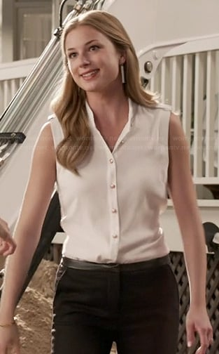 Emily's white top with gold buttons and leather trimmed pants on Revenge