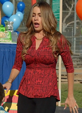 Gloria's red snakeskin top with chain neckline on Modern Family