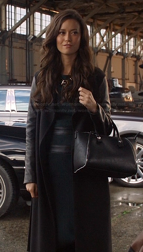 Isabelle's long coat with leather sleeves and black bag on Arrow