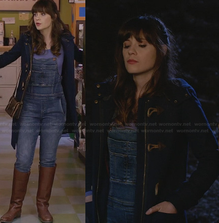 Jess's denim overalls and navy blue toggle coat on New Girl