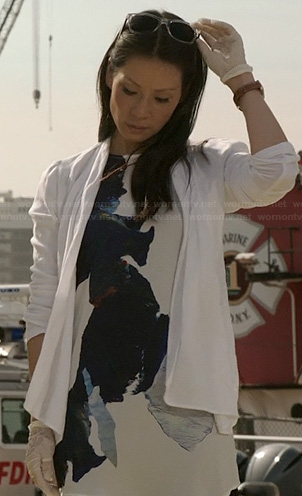 Joan's white abstract printed top on Elementary