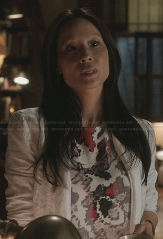 Joan's purple and pink printed tshirt on Elementary