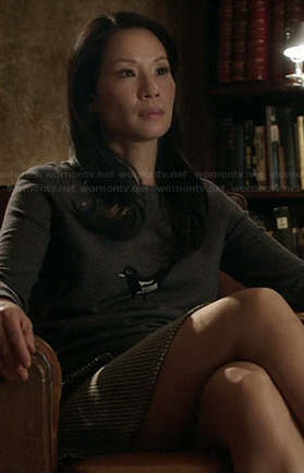 Joan's bird sweater on Elementary