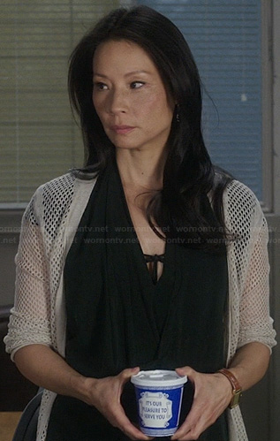Joan's black draped wrap dress and perforated cardigan on Elementary