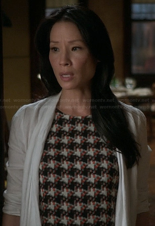 Joan's patterned top on Elementary