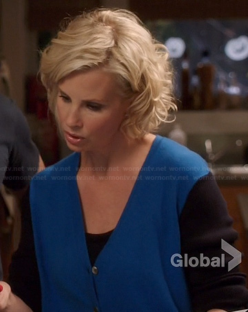 Kristina's blue cardigan with black sleeves on Parenthood