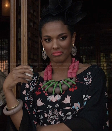 Larissa's black floral dress and chunky bead necklace on The Carrie Diaries