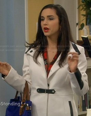 Mandy's white coat with black leather detail on Last Man Standing
