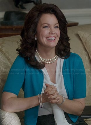 Mellie's white pussy-bow blouse and blue short sleeve cardigan on Scandal