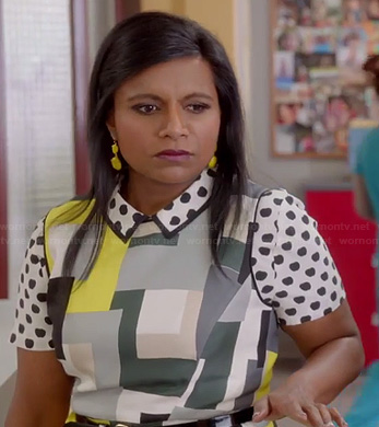 Mindy's white apple polka dot shirt and geometric print dress on The Mindy Project