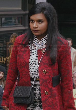 Mindy's red brocade coat, heart print shirt and houndstooth skirt on The Mindy Project