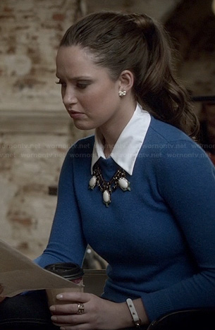 Olivia's blue sweater with elbow patches on Ravenswood