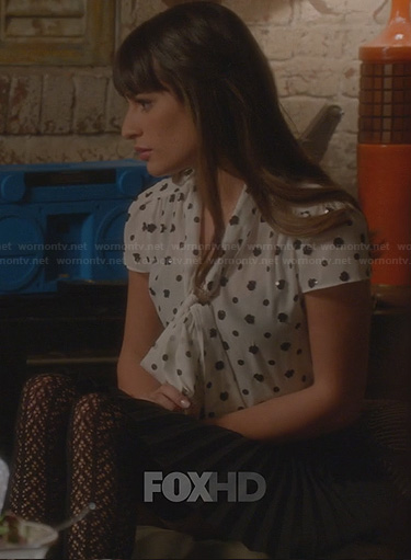 Rachel's white blouse with black sequin spots and pleated skirt on Glee