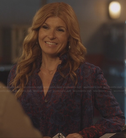 Rayna's purple and red floral printed blouse with red ruffle collar on Nashville