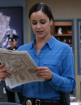 Santiago's mid-blue shirt with pockets on Brooklyn Nine-Nine