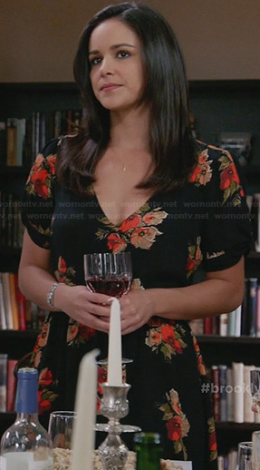 Amy's black floral Thanksgiving dress on Brooklyn Nine-Nine