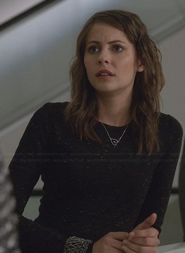 Thea's black speckled long-sleeve dress and heart necklace on Arrow