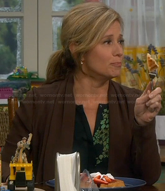 Vanessa's black and green printed blouse on Last Man Standing