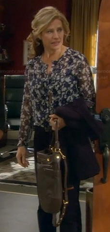 Vanessa's blue floral blouse, elbow patch blazer and black bag on Last Man Standing