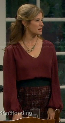 Vanessa's red long sleeve blouse and tweed skirt on Last Man Standing