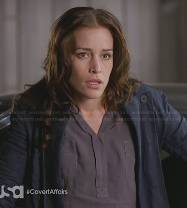 Annie's purple henley and navy trenchcoat on Covert Affairs