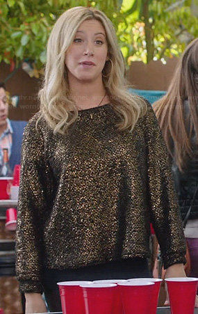 Kelsi's (Ashley Tisdale) gold sweater on The Crazy Ones