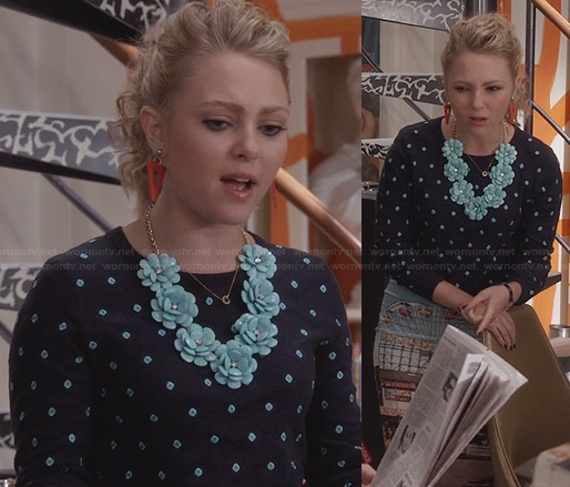 Carrie's navy and turquoise polka dot sweater, flower necklace and graphic printed skirt on The Carrie Diaries