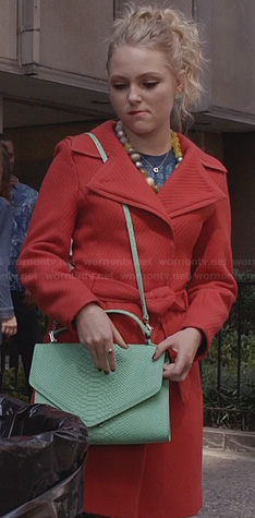 Carrie's red coat and mint green purse on The Carrie Diaries