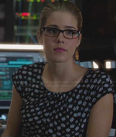Felicity's printed peplum dress and peacock feather earrings on Arrow