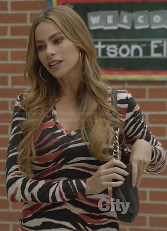Gloria's zebra striped top on Modern Family
