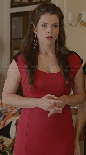 Joanna's red dress with black shoulder detail at Freya's wedding on Witches of East End