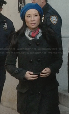 Joan's grey pea coat and blue beret on Elementary