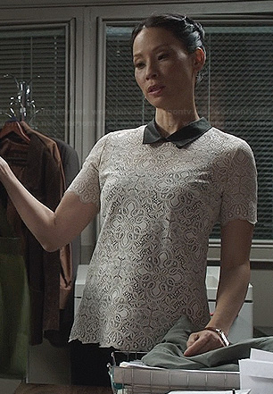 Joan's white lace top with black collar on Elementary