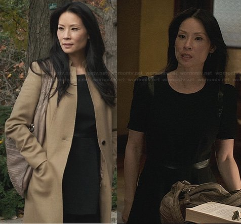 Joan's black leather trimmed dress and long tan coat on Elementary