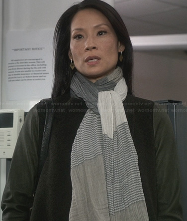 Joan's grey and blue striped scarf on Elementary