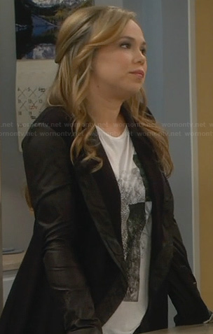 Kristin's white graphic tee and black jacket with leather trim and sleeves on Last Man Standing