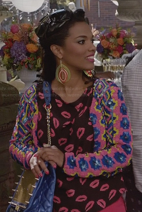 Larissa's sequin floral jacket, lips print top and blue spike studded bag on The Carrie Diaries
