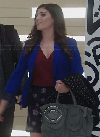 Lauren's blue blazer and floral skirt on The Crazy Ones