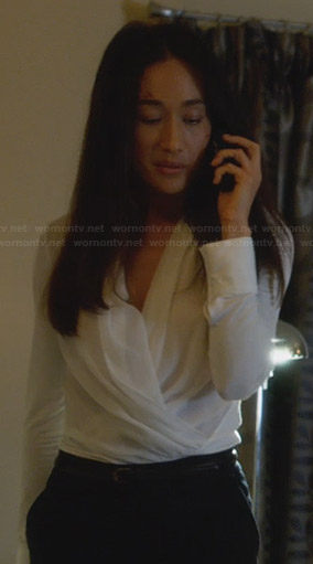 Nikita's white wrap blouse on Nikita