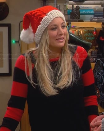 Penny's black sweater with red striped sleeves and knitted Santa hat on The Big Bang Theory