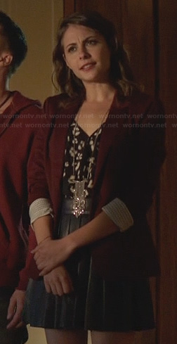Thea's black leather pleated skirt and burgundy blazer on Arrow