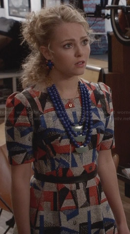 Carrie's red and blue geometric patterned dress with leather trim on The Carrie Diaries