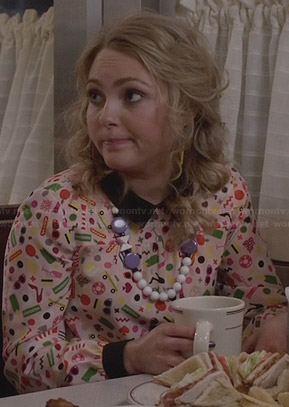 Carrie's multi-colored print blouse with black collar on The Carrie Diaries